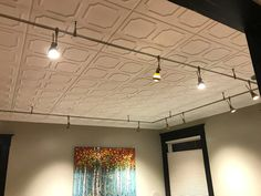 R01 Plain White Styrofoam Ceiling Tiles - Installed in Living and Dining Room