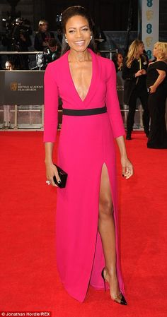 Best Dressed @ 2014 #BAFTA   Naomie Harris in a Gucci hot pink gown with a plunging cleavage styled with Christian Louboutin pumps & a Rauwolf box clutch