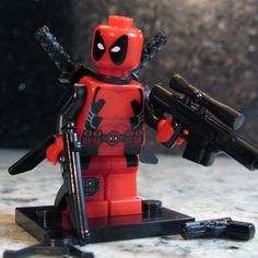 Custom DEADPOOL Minifigure with Lego size Battle Rifle, SMG & more! Marvel X-Men Merc Super Hero Building Toy by ToyAndFashion on Etsy https://www.etsy.com/listing/192070818/custom-deadpool-minifigure-with-lego