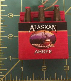 Alaska Amber 6 pack of Beer Christmas Ornament! very cool Alaska collectible!  - When you click on the view page button, it will bring you to the eBay store listing for this ornament.  If you click on the following button, it will take you to our Way Up In Alaska Ornament page - http://www.wayupinalaska.com/Ornaments.html