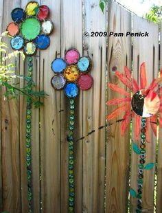 From facebook; Junky, Funky, Rusty, and Re-purposed by Sue.  Great way to us old paint can lids and bottle caps.