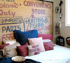 One funky guest room/play room reveal with an old sign headboard