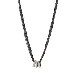 The 3 ring necklace pendant is made with a black chain, three silver…