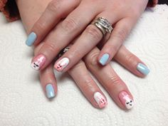 Pale blue with pink and white bunny accent nails  Oasis Salon and Spa Mill Hall Pa (570)726-6565