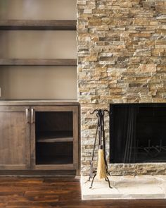 Remodeled fireplace and shelving.