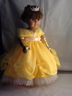 Inspired by Princess Belle from Disneys Beauty and the Beast this is my interpretation of her beautiful gown and accessories. Since I first offered Princess Elsa last year, I have had requests to design additional Princess gowns, so this is the second in my new line of Princesses for the American Girl size doll. Belles gown has multiple layers of sunshine yellow organza over an additional layer of yellow satin trimmed in crystal pleated lace. Each tuck at the hem of the organza is secured…