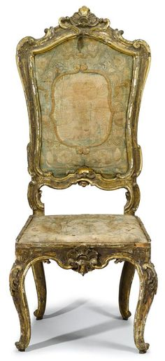 Italian rococo gilt painted hall chair   18th century   The scallop crested top rail over needlework upholstered back and drop-in seat, raised on cabriole legs.