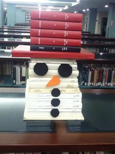 Here's a cute snowman face make out of books. It is a perfect winter library display.