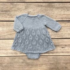 Tiny Tulips is a special one-piece for baby girls: a three-quarter-length sleeve romper with simple-cable hem and cuffs, and a full lace skirt with a pattern inspired of springtime budding tulips. Knitting For Kids, Baby Knitting Patterns, Baby Patterns, Knit Baby Dress, Knitted Baby Clothes, Crochet Baby, Knit Crochet, Baby Barn, Tulip Dress