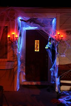 Halloween: How To Create A Haunted House including effect for a spooky entrance! Good way to decorate transitions ...love the glow in blacklight spider webs. Cover the porch next year!!!!!!!!!!!!