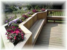 like the bench and flower planter idea as an alternative to railing entire deck - great idea for my herb garden!!
