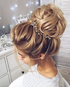 This beautiful high bun wedding hairstyle perfect for any wedding venue This s