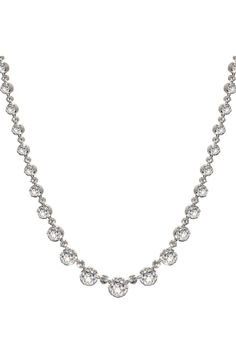 18K white gold plating over sterling silver with over 40 white sapphires (yellow gold plating available upon request). Adjustable chain can be worn anywhere between 15.5 - 17.5 inches.