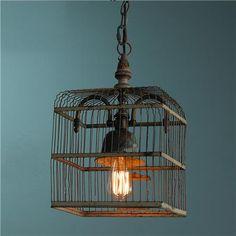 repurposed vintage birdcage light fixture (http://www.flickr.com/photos/restoringstyle/)