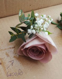 Amnesia Rose buttonhole with Gypsophila and Eucalyptus detailing