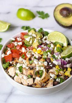 A healthy, homemade version of a Chipotle Burrito Bowl made with chicken, quinoa, and avocado.