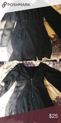 Black romper with a low back Black romper that has pockets on the side. The back (second picture) is low cut with a gold zipper. Super cute and flows pretty. Never worn, had it thrown in the bag since I purchased it. Just took the tags off to wash it so it smells nice for you! Size is XS but fits like a small. Didn't fit me so I'm selling to you! :) Price is negotiable! GB Other