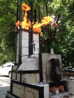 Liming Zhang, kiln under fire. Mini kilns in Jingdezhen at The Pottery Workshop, China