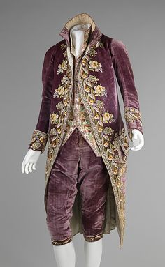 ca. 1810 Court suit. This three piece suit is exemplary of skilled French embroidery and the silhouette of men's court wear during the time of Napoleon Bonaparte (1769-1821). The intricate embroidery pattern is intriguingly mimicked between the waistcoat and coat, reinforcing its status as a full suit.
