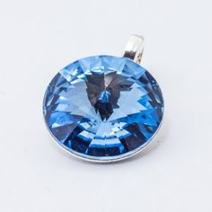 Silver plated Swarovski Rivoli Pendant 12mm Light Sapphire  Dimensions: length: 1,7cm stone size: 12mm Weight ~ 1,40g ( 1 piece ) Metal : silver plated brass Stones: Swarovski Elements 1122 12mm Colour: Light Sapphire 1 package = 1 piece Price 9.40 PLN(about 2.5 EUR) Swarovski Pendant, 1 Piece, Silver Plate, Silver Jewelry, Sapphire, Pendants, Brass, Sterling Silver, Stone