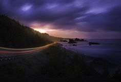 I think this is the most beautiful stretch of HW101 along the Oregon Coast.  I should know, I just drove the entire thing... twice.  It's hard to tell what your sensor will pick up during a long exposure.  This was a 91 second exposure and even though the sun had yet to rise, my camera really absorbed a lot of light.  I saw one or two stars still lingering while I was shooting and the camera picked up on a few more.  I had to replace them with ones that weren't streaking though.  Also you'll…