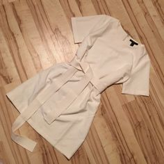 NWT Forever 21 Cream sheets dress with tie belt NWT Forever 21 short sleeve sheets dress with white sash tie. Back zip; fits loosely. Brand new!  offers! Open to trades! Forever 21 Dresses Mini
