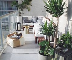 A small balcony design that maximizes a corner. Modular outdoor seating in the form of armless chairs can be grouped to expand or be repositioned.  Source: The Habitat Collective