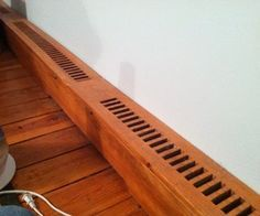 This is an instructable about making wooden baseboard heater covers. We bought an old home and when I refinished the floors in my bedroom the metal ones were all rusted . Baseboard Radiator, Baseboard Heater Covers, Electric Baseboard Heaters, Wood Baseboard, Baseboard Styles, Baseboard Heating, Baseboards, Radiator Cover, Houses