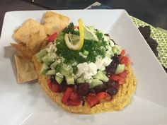 Serve up some comfort food on the buffet table for the big game. </br> </br> What your chip-dippers will go after is this Greek-style variation on the typical Seven Layer Dip. Food Decoration, Decorations, Seven Layer Dip, Roasted Beet Salad, 7 Layers, Hors D'oeuvres, Avocado Toast, Tapas, Greek