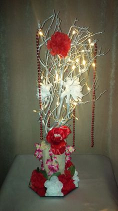 Red Rose Floral Centerpiece with LED Lights for Weddings and Events.  For info visit C&C Custom Creations on Facebook.