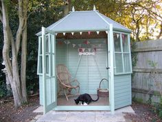 We love the relaxed-as-a-cat look of this cute hexagonal summer house. It's … We love the relaxed-as-a-cat look of this cute hexagonal summer house. It's the perfect place for a sunny afternoon with a nose in a good book. Small Summer House, Corner Summer House, Summer House Garden, Home And Garden, Summer Houses, She Shed Decorating Ideas, Wendy House, Backyard Movie, Glass House