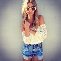 Love the lace off the shoulder top with long sleeves and short light blue jeans.