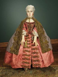 18th Century Venetian Court Doll, circa 1780. Silk damask open robe, silk faille cape, stockings with knee garters, brocade heeled shoes, accessories including black domino and bauta masks, and tricorn.