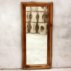 Add a functional decorative accent to a bedroom or hallway with this reclaimed wood floor mirror. Handcrafted in Thailand, each sturdy teak mirror has unique detailing and features a walnut oil finish to help it complement virtually any decor.