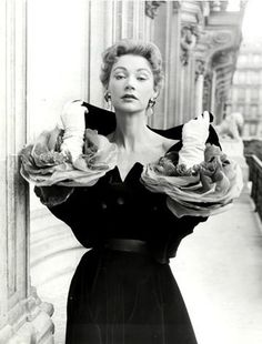 1953 Sophie Malgat in dress with cuffs of layered organdy petals to look like roses, by Givenchy