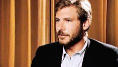 Young Harrison Ford smiling...with a beard...I just forgot everything that I have done today