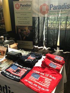 Some of our great t-shirts at the #FedEx expo. #FlagsFromParadisoIns
