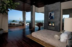 Interior: Gorgeous View At Night From Inside 1525 Blue Jay Way Near Clear Sofa Along With Armchairs With Darkwood Coffee Table from Reviewing Interior Design for House of Hollywood Artists