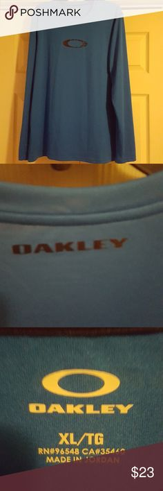 Oakley long sleeve. A really nice color blue with black trim and logo on front and back. This looks new. Oakley Shirts Tees - Long Sleeve