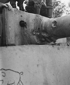 A Tiger 1 has the battle scars from heavy fighting that shows the value of heavy armor protection built into the tank design