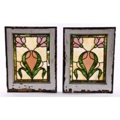 matching set of early 20th century art nouveau style leaded art glass residential side light windows. the vibrantly colored and streaked opalescent cathedral roll glass remains largely intact, with a few age old hairline cracks and a single damaged border panel shown in the window on the left. the c. 1907-5 windows were fabricated by h. eberhardt & co., chicago, il. each window measures 21 x 16 inches. priced for the pair. $450