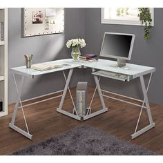 Crafted from powder coated steel and tempered safety glass. Features a corner wedge for space-saving needs. Includes a CPU stand and sliding keyboard tray. A flexible configuration allows the keyboard tray to be mounted on either side of the desk.
