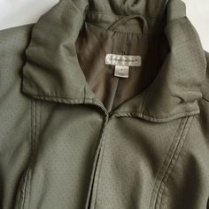 """Vegan leather Olive Green Jacket Preowned jacket in really good and clean condition! Super cute and tailored. Ruffly collar with hook front closure. Perforated faux leather in olive green muted tone. Measures 23""""L. Sleeves 25.5""""L. Armpit to armpit 20""""W Christopher & Banks Jackets & Coats"""