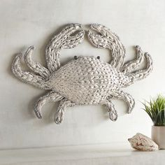 Where will you place our charming crustacean? We think the kitchen would be nice, but a sunroom or coastal-themed living room would work, too. Woven of seagrass, it has a wash of antique white paint to give it that weathered, beachcomber look.