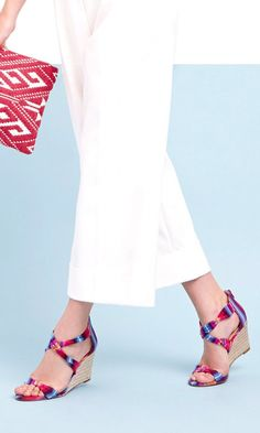 Wedge espadrille sandals with an open toe, stacked leather heel, twisted fabric straps and an easy back zipper.