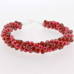 Kumihimo Bracelet - Red  You must have a go at these bracelets, they are so easy to make and very pretty. They come with full instructions for you to use. I am sure all your friends will be asking you to make one, but don't tell them it only cost £4.99.