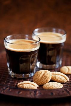Espresso - coffee brewed by forcing a small amount of nearly boiling water under pressure through finely ground coffee beans. Espresso is generally thicker than coffee brewed by other methods, has a higher concentration of suspended and dissolved solids, and has crema on top (a foam with a creamy consistency). #Coffeetime