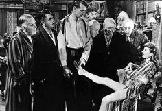 BALL OF FIRE - Burlesque dancer (Barbara Stanwyck) mesmerizes Gary Cooper and a group of his fellow professors while hiding from mobsters - Produced by Samuel Goldwyn Company - Directed by Howard Hawks - RKO-Radio - Publicity Still. Gary Cooper, Barbara Stanwyck, Marlene Dietrich, Old Movies, Great Movies, Vintage Movies, Classic Hollywood, Old Hollywood, Actor Secundario