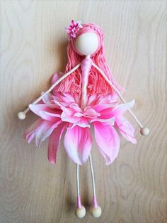 Meet Dahlia, a one-of-a-kind flower doll. Standing at 9 3/4 inches tall by 5 1/2 inches wide, she is ready to ship ! Dahlia is made using floral wiring and chenille stems to give her a pose-able feature. Please keep in mind that even though her whole body is pose-able, excessive