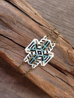 Hey, I found this really awesome Etsy listing at https://www.etsy.com/listing/245840947/masana-seed-bead-and-brass-chain